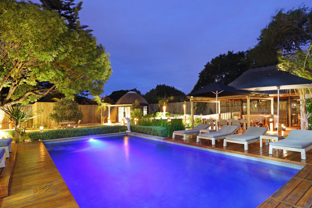 Evening shot of the pool area at Garden Retreat